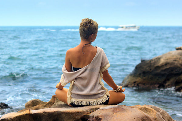 Yoga - Frau am Strand